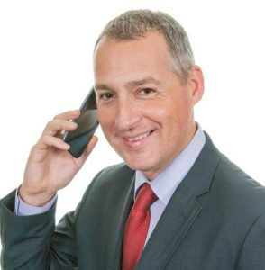 Mature Male Businessman smiling on phone (portrait)