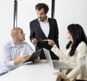 Business manager discussing with the employs