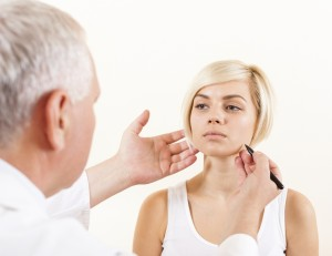 doctor male plastic surgeon with patient examine woman, draw on face
